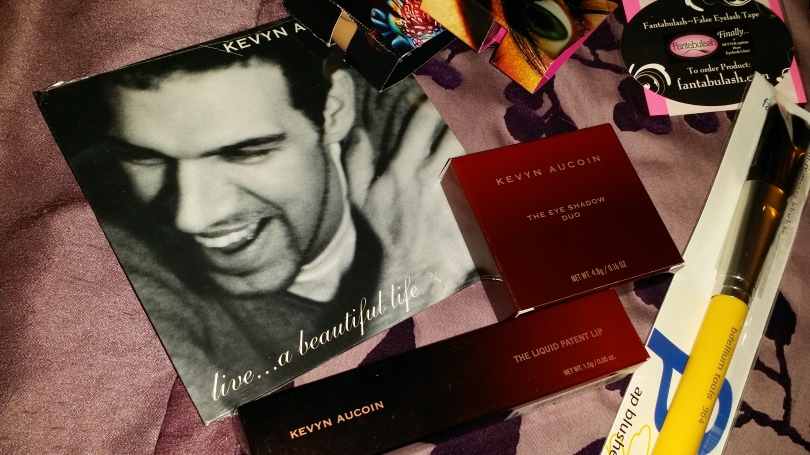 Kevin Aucoin music mix cd, an eyeshadow duo and one of the last products he had a hand in making, the Liquid Patent Lip in Jupitesse. It's no longer being made.